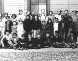 1910 or 1911 Tommy Geary Sr., holding 4th grade sign at Jerome School.