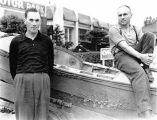 [Thurman Hickam and Buzz Holmstrom posing with Holmstrom's boat, returning from Minneapolis.]