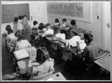 [Children at their desks in classroom at Keams Canyon Boarding School].