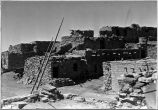 2-story houses-Kiva in foreground. Mishongnovi Village- 2nd Mesa. March 1944. Photograph by Milton...
